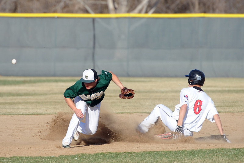 Loveland High School's John Tower, right, slides safely into second base for a steal ahead of the throw to Bear Creek shortstop Devin Rumsey in the bottom of the fifth inning of their game Thursday, April 4, 2013 at Centennial Field.