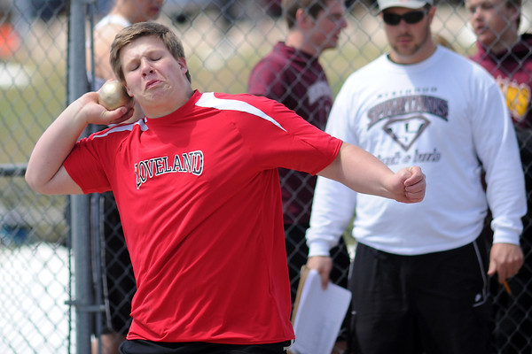 Loveland High School junior Kade Keefauver makes a throw during the shot put event during the R2J Invitational meet on Wednesday, April 24, 2013 at LHS.