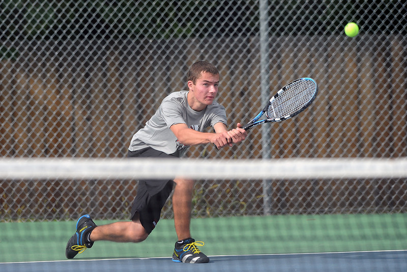 Loveland High School sophomore Cory Winkelhake hits a backhand during his match against Thompson Valley's Logan Bonawitz on Thursday, Aug. 30, 2012 at TVHS.