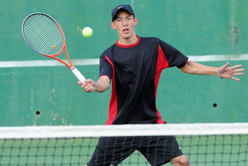 Loveland High School's Garet Davis hits a volley during practice on Friday, Aug. 17, 2012 at the North Lake Park tennis courts. He is one of a cluster of sophomores looking to keep the Indians in the thick of the Front Range League this season. Davis, who coaches with CARA in the summer, made the leap from No. 2 doubles all the way to No. 2 singles and expects to live up to the challenges of playing older opponents.