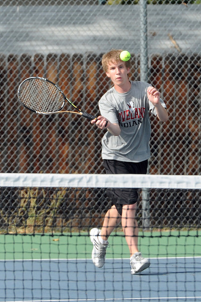 Loveland High School's Colton Poore returns a shot during his No. 2 doubles match with teammate Tanner Foster against Thompson Valley's Justin Hartzog and Grant Rohrbouck on Thursday,  Aug. 30, 2012 at TVHS.