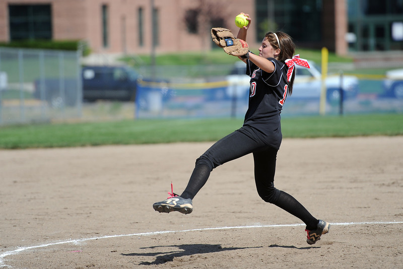Loveland High School's Cassidy Smith winds up before throwing a pitch in the bottom of the fifth inning of a game against Mountain View on Saturday, Aug. 25, 2012 at MVHS.