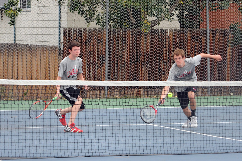Loveland High School's Garrett Donaldson, right, lunges at the net while No. 4 doubles teammate Tyler Helfrich, looks on during their match against Thompson Valley's Jacob Schafer and Wesley Wilson on Thursday, Aug. 30, 2012 at TVHS.
