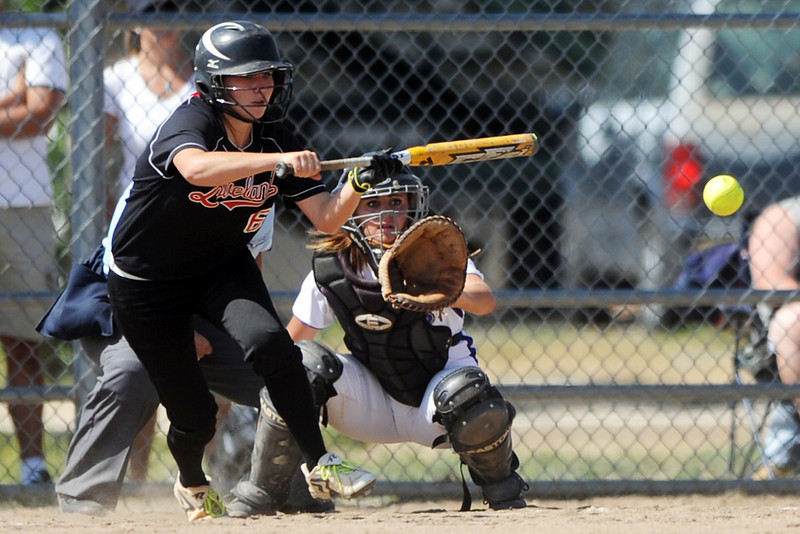 Loveland High School's Colissa Bakovich lays down a bunt in the top of the fifth inning of a game against Mountain View while catcher Ali Reed looks on Saturday, Aug. 25, 2012 at MVHS.