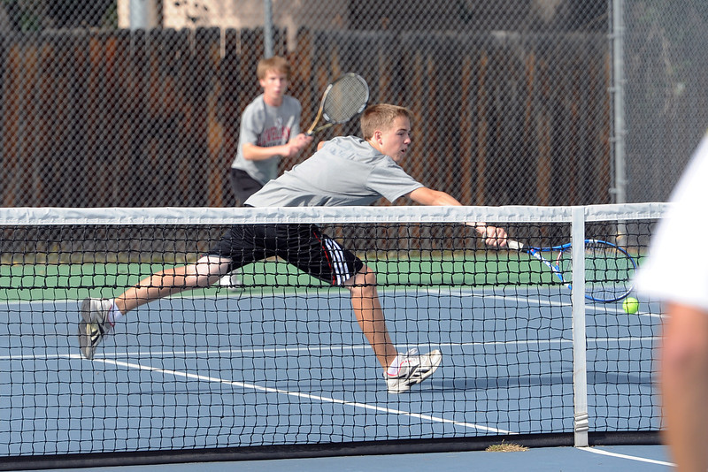 Loveland High School's Tanner Foster stretches out for a shot at the net while No. 2 doubles partner Colton Poore looks on during their match against Thompson Valley's Justin Hartzog and Grant Rohrbouck on Thursday, Aug. 30, 2012 at TVHS.