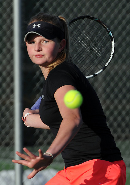 Loveland High School tennis player Becca Weissmann practices at the school in Loveland on Tuesday, March 5, 2013.
