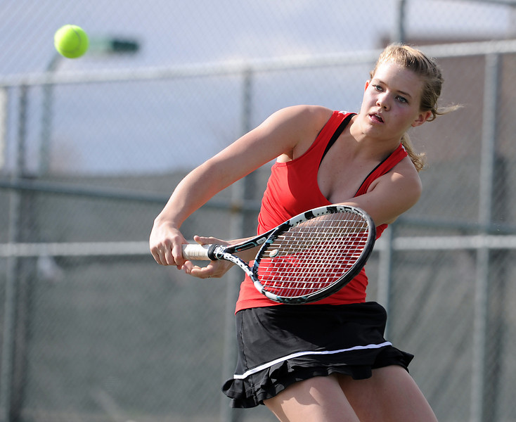 Loveland High School #3 singles tennis player Kim Weissmann during a match at Loveland High on Thursday, March 28, 2013.