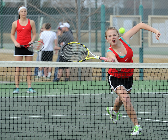 Loveland High School #3 doubles tennis players Colleen Weeks, left, and Sydney Brummet, right, during a match  Loveland High on Thursday, March 28, 2013.