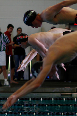 Cooper J Bowen, center, competes in the Men's 500 yard Freestyle at the Mountain View Aquatic Center Tuesday, March 12, in Loveland, Colo.