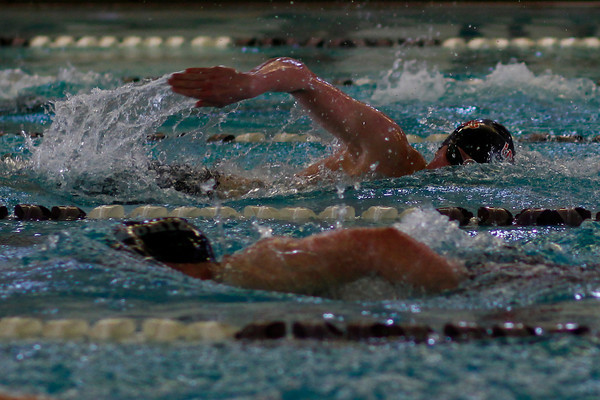 Cooper J Bowen, top, pulls well ahead of the competition in the Men's 500 Yard Freestyle at Mountain View Aquatic Center Tuesday, March 12, in Loveland, Colo.