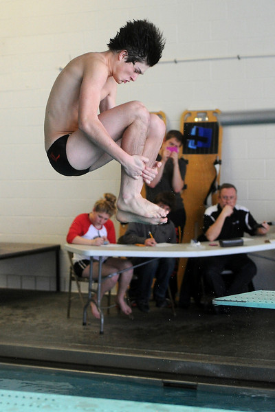 Loveland High School's Oryan Gloer performs a dive during a Front Range League double dual meet Tuesday, March 26, 2013 at the Mountain View Aquatic Center.