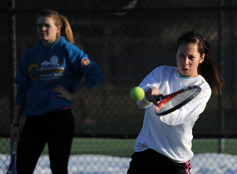 Loveland High School tennis player Ashyln Wong practices at the school in Loveland on Tuesday, March 5, 2013.