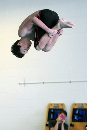 Loveland High School's Hunter Klenk performs a dive during a Front Range League double dual meet Tuesday, March 26, 2013 at the Mountain View Aquatic Center.
