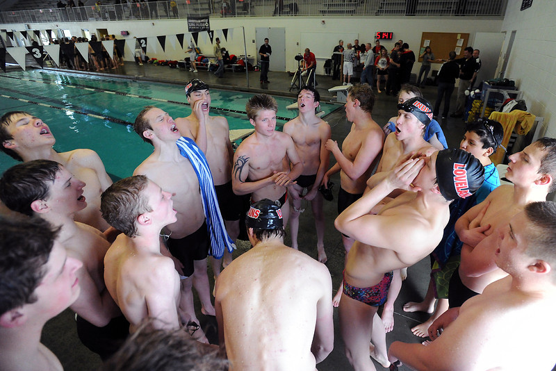 Loveland High School boys swim team members let out a yell together at the end of a Front Range League double dual meet Tuesday, March 26, 2013 at the Mountain View Aquatic Center.