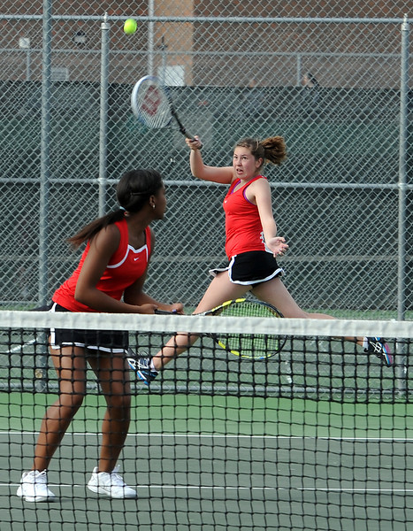 Loveland High School #2 doubles tennis players Suzi Hummel, left, and Kelsey Schneider, right, during a match  Loveland High on Thursday, March 28, 2013.