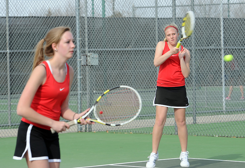 Loveland High School #1 doubles tennis players Katie McNaught, left, and Katie Nottberg, right, during a match  Loveland High on Thursday, March 28, 2013.