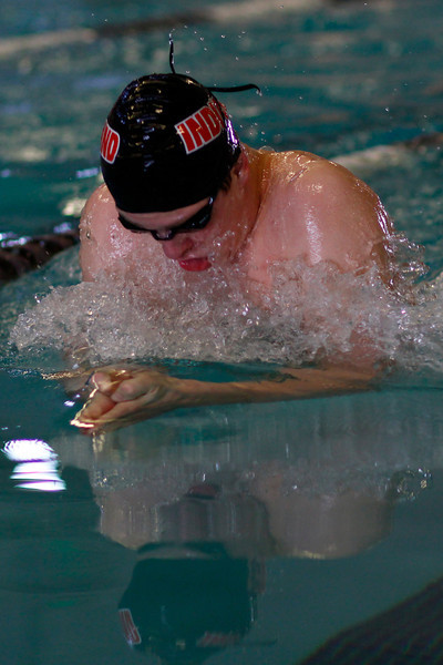 Ethan McNally competes in the Men's 100 yard Breaststroke at the Mountain View Aquatic Center Tuesday, March 12, in Loveland, Colo.