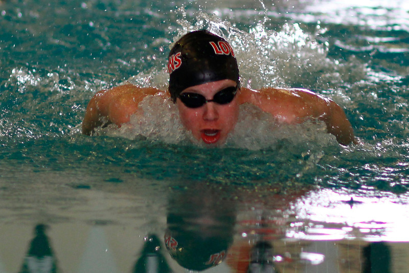 Ryan Ball competes in the  Men's 100 yard Butterfly at the Mountain View Aquatic Center Tuesday, March 12, in Loveland, Colo.