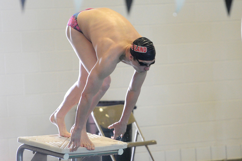 Loveland High School's Ethan McNally at the start of the 50-yard freestyle during a meet Tuesday, March 12, 2013 at the Mountain View Aquatic Center.