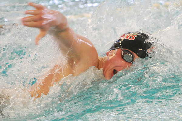 Loveland High School sophomore Dylan McNally swims in the 100-yard freestyle final during a Front Range League double dual meet Tuesday, March 26, 2013 at the Mountain View Aquatic Center.