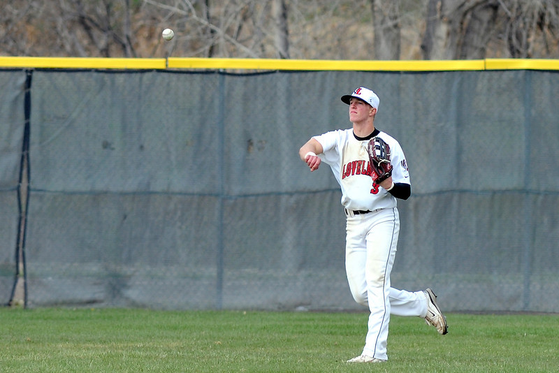 Loveland High School center fielder Greg Hecker throws the ball in after fielding a hit in the top of the fourth inning of a game against Fossil Ridge on Tuesday, April 30, 2013 at Swift Field.