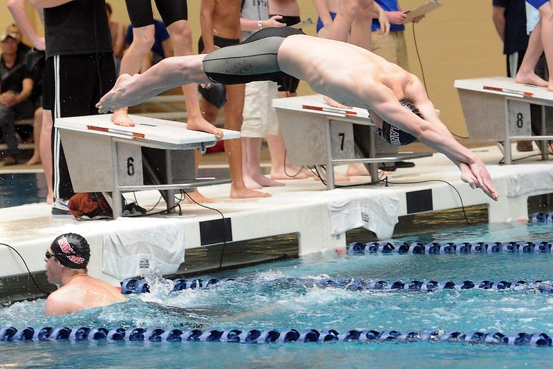 Loveland High School's Dylan McNally dives into the pool to swim the freestyle leg after teammate Ethan McNally touched the wall while competing in the 200-yard medley relay during the Conference Championships on Saturday, May 11, 2013 at Veterans Memorial Aquatic Center in Thornton, Colo.