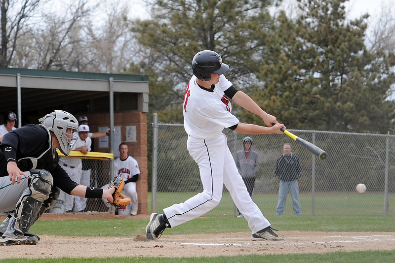 Loveland High School sophomore Jake Weinmaster hits a single in the bottom of the first inning of a game against Fossil Ridge on Tuesday, April 30, 2013 at Swift Field.