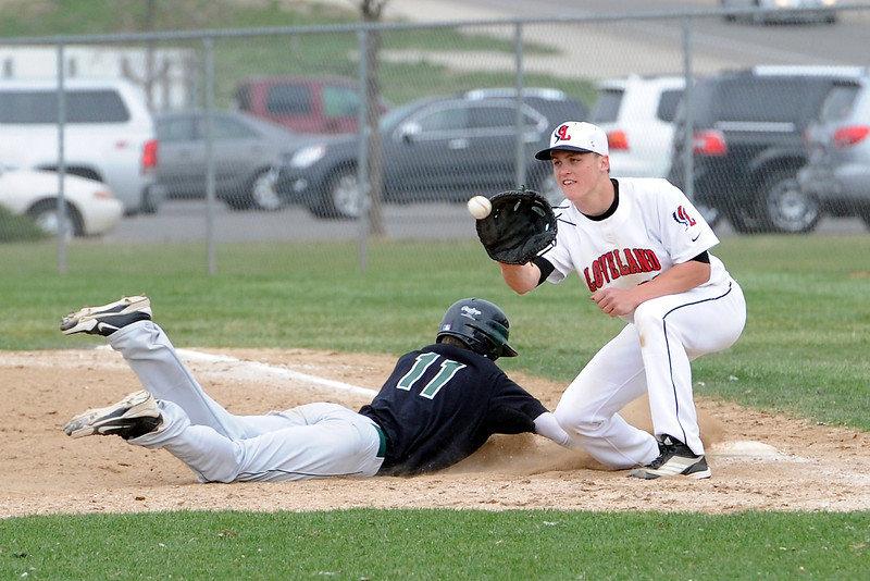 Loveland High School first baseman Jake Weinmaster waits for the throw on a pickoff attempt of Fossil Ridge baserunner Logan Waterland in the top of the fourth inning of their game Tuesday, April 30, 2013 at Swift Field.