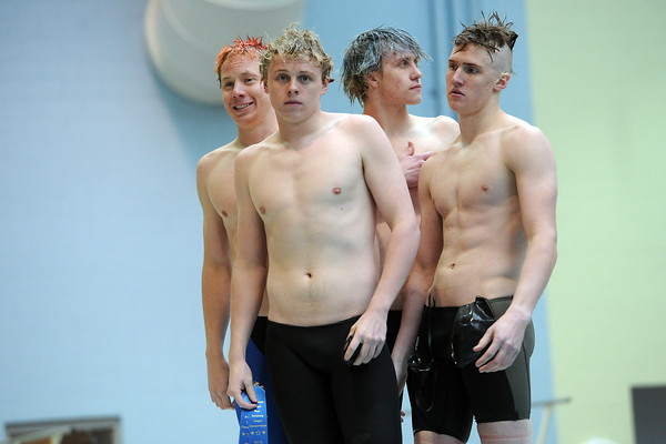 Loveland High School teammates stand together after being awarded first place ribbons for winning the 400-yard freestyle relay during the Conference Championships on Saturday, May 11, 2013 at Veterans Memorial Aquatic Center in Thornton, Colo.