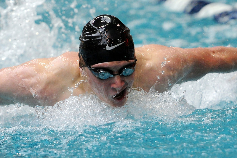 Loveland High School's Erik Trenary swims in the 100-yard butterfly final during the Conference Championship on Saturday, May 11, 2013 at Veterans Memorial Aquatic Center in Thornton, Colo.