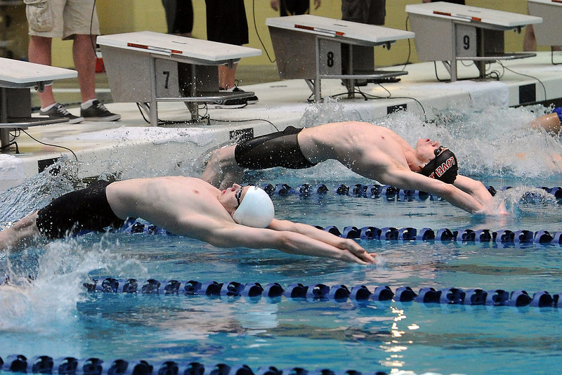 Loveland High School's Ryan Ball, left, and Pat Jones enter the water at the start of the 100-yard backstroke final during the Conference Championships on Saturday, May 11, 2013 at Veterans Memorial Aquatic Center in Thornton, Colo.