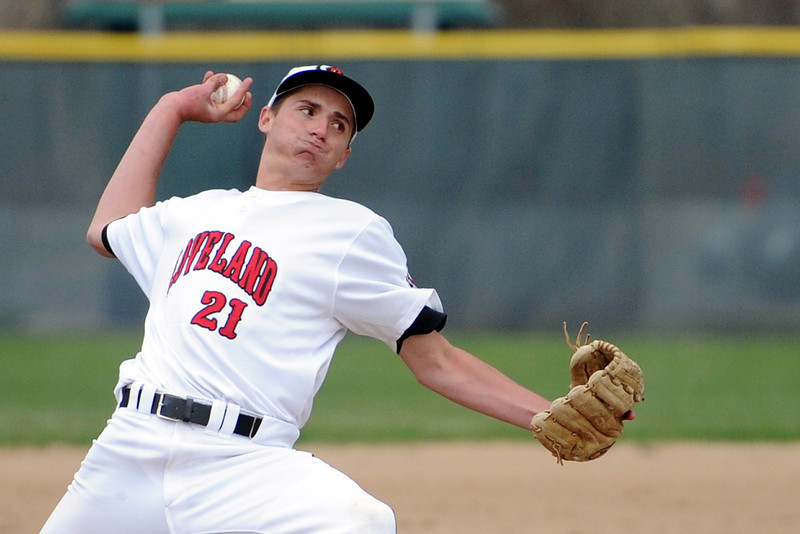 Loveland High School junior Seth Bernhardt throws a pitch in the top of the fifth inning of a game against Fossil Ridge on Tuesday, April 30, 2013 at Swift Field.
