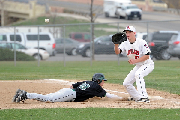 Loveland High School first baseman Jake Weinmaster waits for the throw on a pickoff attempt of Fossil Ridge baserunner Corey Peter in the top of the fourth inning of their game Tuesday, April 30, 2013 at Swift Field.