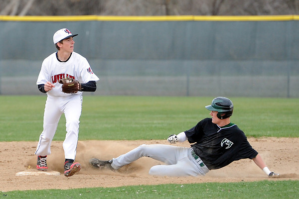 Loveland High School shortstop JC Schneider steps on second base to force out Fossil Ridge baserunner Corey Peter in the top of the fifth inning of their game Tuesday, April 30, 2013 at Swift Field.