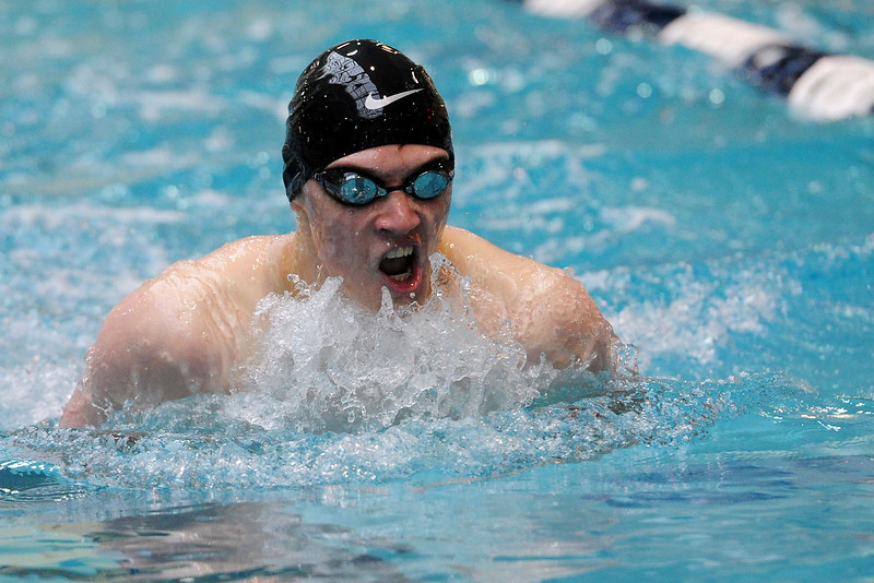 Loveland High School's Erik Trenary swims in a consolation heat of the 100-yard breaststroke during the Conference Championships on Saturday, May 11, 2013 at Veterans Memorial Aquatic Center in Thornton, Colo.