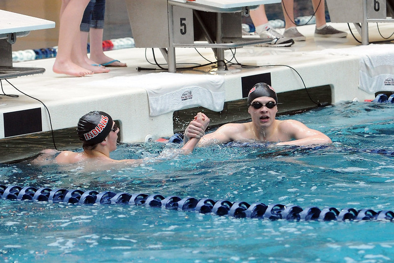 Loveland High School senior Ethan McNally, right, shakes hands with Dylan McNally after the brothers competed in the 100-yard freestyle final during the Conference Championship on Saturday, May 11, 2013 at Veterans Memorial Aquatic Center in Thornton, Colo.