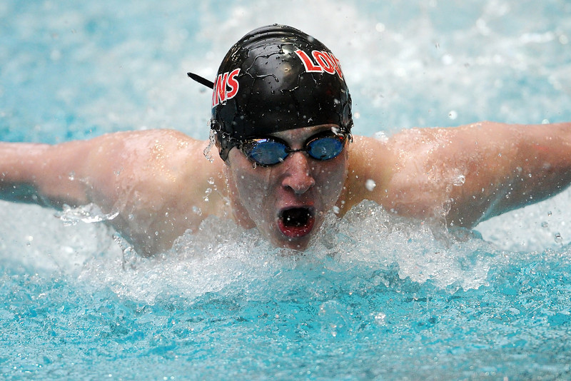 Loveland High School sophomore Colton Mitchell swims in a consolation heat of the 100-yard butterfly during the Conference Championships on Saturday, May 11, 2013 at Veterans Memorial Aquatic Center in Thornton, Colo.