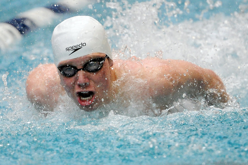 Loveland High School's Ryan Ball swims in the 100-yard butterfly final during the Conference Championships on Saturday, May 11, 2013 at Veterans Memorial Aquatic Center in Thornton, Colo.