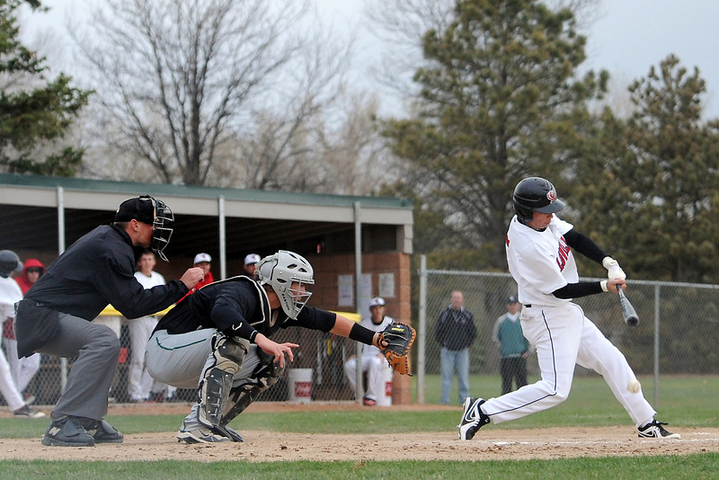 Loveland High School junior Dylan Underwood hits a slow-roller single which drove in two runs in the bottom of the sixth inning of a game against Fossil Ridge on Tuesday, April 30, 2013 at Swift Field.