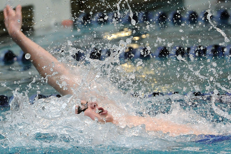 Loveland High School's Ryan Ball swims in the 100-yard backstroke final during the Conference Championships on Saturday, May 11, 2013 at Veterans Memorial Aquatic Center in Thornton, Colo.