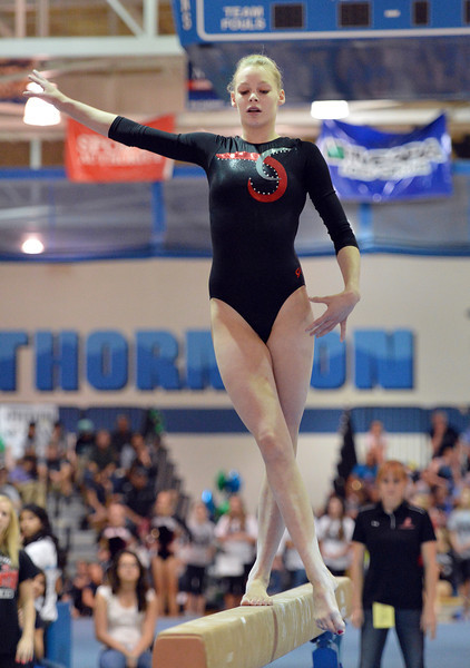Loveland's Claire Hammen performs on the beam at the state 5A gymnastics competition at Thornton High School on Friday