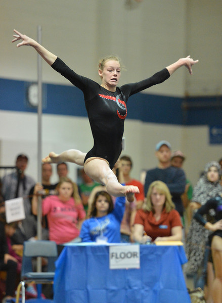 Loveland's Claire Hammen performs on the floor at the state 5A gymnastics competition at Thornton High School on Friday, Nov. 2, 2012.