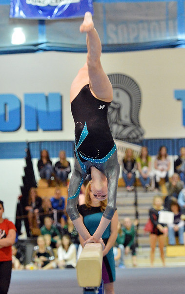 bent1104LOVEgymindividual338.JPG Loveland's Claire Hammen  performs on the uneven parallel bars during the state individual gymnastics competition at Thornton High School on Saturday.<br /> <br /> November 3, 2012<br /> staff photo/ David R. Jennings