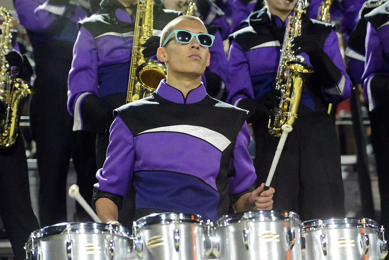 Mountain View High School sophomore Julian Von Holten 16, plays tenor drums up in the stands with the marching band during a football game against Loveland on Friday, Nov. 2, 2012 at Patterson Stadium.
