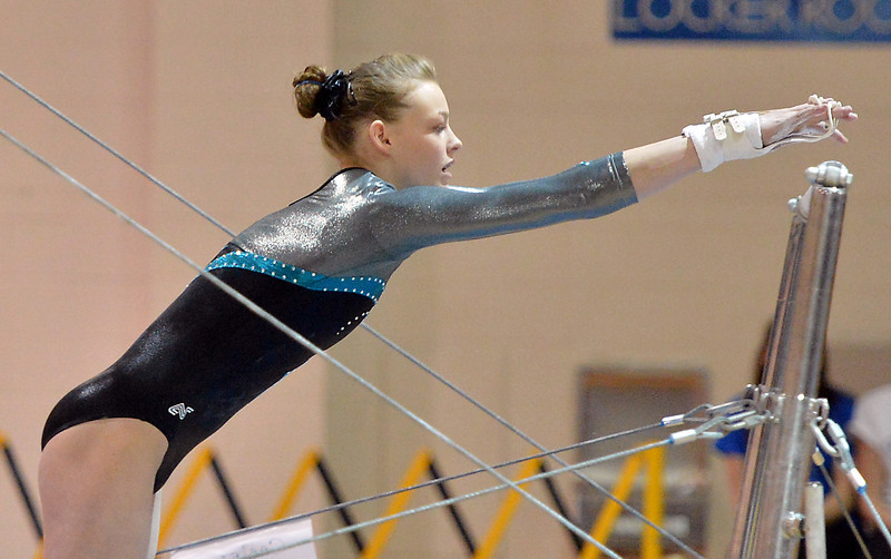 bent1104LOVEgymindividual03.JPG Loveland's Claire Hammen  performs on the uneven parallel bars during the state individual gymnastics competition at Thornton High School on Saturday.<br /> <br /> November 3, 2012<br /> staff photo/ David R. Jennings