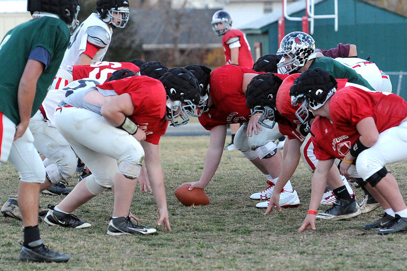 Loveland HIgh School football players practice together on Thursday, Nov. 8, on the practice field outside the school in preparation for their playoff game against Pueblo West.