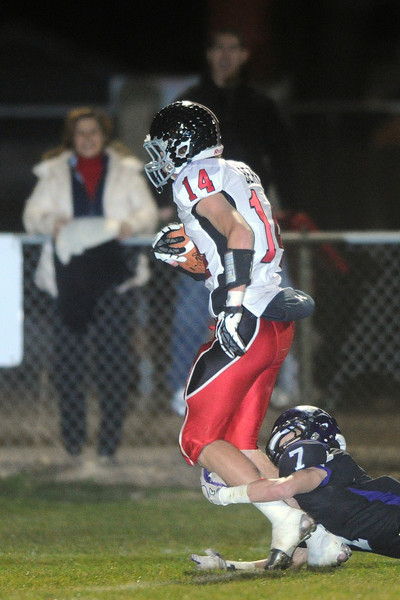 Loveland High School wide receiver Tanner Berry (14) eludes Mountain View defender Justin Dennis on his way to the end zone for a touchdown after making a catch in the first quarter of their game on Friday, Nov. 2, 2012 at Patterson Stadium.
