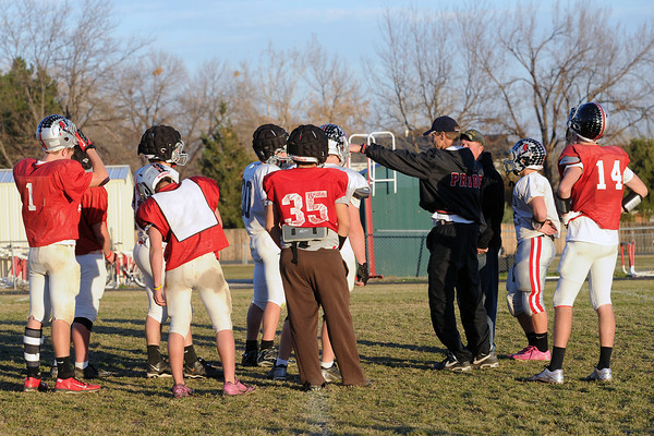 Loveland High School players and coaches work on a drill during practice Thursday, Nov. 8, 2012 outside the school.