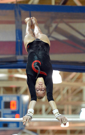 Loveland's Claire Hammen performs on the uneven parallel bars at the state 5A gymnastics competition at Thornton High School on Friday.