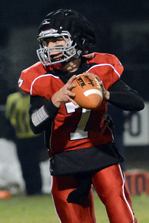 Loveland High School quarterback Graham Weeks looks for an open receiver on a point-after-touchdown attempt during  game against Longmont on Friday, Oct. 26, 2012 at Patterson Stadium.